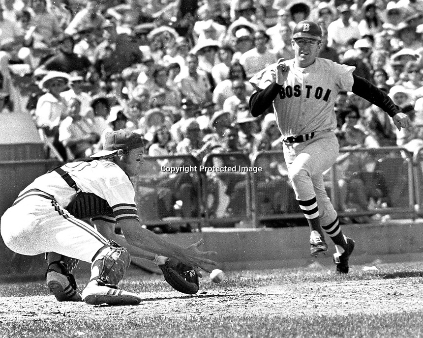 Oakland A's catcher Dave Duncan fields throw to the plate in time to tag out Boston Red Sox runner...<br />(1972 photo/Ron Riesterer)