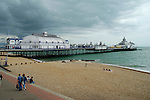 Threatening storm clouds over Eastbourne Pier and beach, East Sussex, England