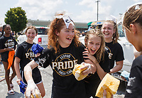 NWA Democrat-Gazette/CHARLIE KAIJO Madison Schluterman, 12, and Shelby Rogers, 12, (from center left) laugh with Lincoln Jr. High School cheerleaders while washing cars, Sunday, August 5, 2018 at the parking lot of Sport Clips in Bentonville. <br />
