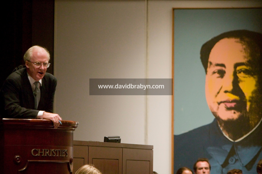 14 November 2006 - New York City, NY - Principal auctioneer Christopher Burge takes bids during a sale of Post-War and Contemporary Art at the Christie?s auction house in New York City, USA, 14 November 2006. The sale reached a total of $239,704,000. Photo Credit: David Brabyn/Sipa Press<br />