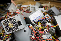 12/4/2008 3:46:36 PM -- Seattle, WA.Computer power supplies are separate into a bin at Total Reclaim Inc., Environmental Services in Seattle Thursday Dec. 4, 2008.