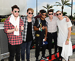 SUNRISE, FL - DECEMBER 21: L-R) Musicians Charley Bagnall, Danny Wilkin, Lewi Morgan, Jake Roche of the band Rixton and Orion Paxx (C) poses backstage at Y100's Jingle Ball Village, Y100's Jingle Ball 2014 official pre-show at BB&T Center on December 21, 2014 in Sunrise, Florida.  (Photo by Johnny Louis/jlnphotography.com)