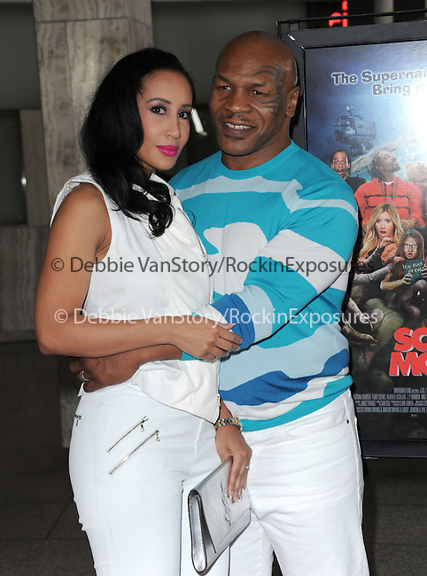 Mike Tyson and his wife at The Dimension Films Premiere of Scary Movie V held at The Cinerama Dome in Hollywood, California on April 11,2013                                                                   Copyright 2013 Hollywood Press Agency