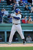 Designated hitter Josh Fuentes (19) of the Asheville Tourists bats in a game against the Greenville Drive on Thursday, April 7, 2016, at Fluor Field at the West End in Greenville, South Carolina. Greenville won, 4-3. (Tom Priddy/Four Seam Images)