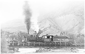 Fireman's-side view of D&amp;RGW #360 on the wye bridge while switching at Cimarron, CO.<br /> D&amp;RGW  Cimarron, CO  7/1949