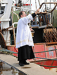 Fr Paul Clayton Lee blesses the fishing boats on Clogherhead pier. Photo: Colin Bell/pressphotos.ie