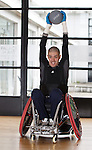 Paralympian wheelchair rugby player Mike Kerr during a training session at the Palace of Art in Govan, Glasgow. Medicine ball training in his new wheelchair.