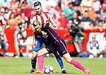 Sporting de Gijon's Moi Gomez (b) and FC Barcelona's Lucas Digne during La Liga match. September 24,2016. (ALTERPHOTOS/Acero)
