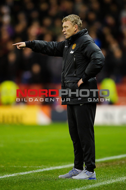 Man Utd Manager David Moyes (SCO) points from the touchline during the second half of the match -  - 18/12/2013 - SPORT - FOOTBALL - Britannia Stadium, Stoke - Stoke City v Manchester United - Capital One Football League Cup Quarter-Final.<br /> Foto nph / Meredith<br /> <br /> ***** OUT OF UK *****
