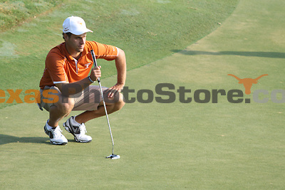 University of Texas redshirt senior Jonathan Schnitzer eyes his putt during the Carpet Capital Collegiate at The Farm Golf Club in Rocky Face, Ga., on Sunday, Sept. 8. The Longhorns return to The Farm as defending champions after shooting a 13-under 851 in 2012.<br /> <br /> Photo by Patrick Smith
