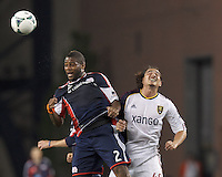 New England Revolution defender Andrew Farrell (2) and Real Salt Lake forward Devon Sandoval (49) battle for head ball.  In a Major League Soccer (MLS) match, Real Salt Lake (white)defeated the New England Revolution (blue), 2-1, at Gillette Stadium on May 8, 2013.