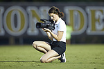 Wake Forest assistant director of multimedia Mackenzie Smith takes video prior to the start of the NCAA men's soccer match between the North Carolina State Wolfpack and the Wake Forest Demon Deacons at W. Dennie Spry Soccer Stadium on September 7, 2018 in Winston-Salem, North Carolina.  The Demon Deacons defeated the Wolfpack 3-0 in double-overtime.  (Brian Westerholt/Sports On Film)