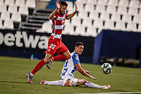 22nd June 2020; Estadio Municipal de Butarque, Madrid, Spain; La Liga Football, Club Deportivo Leganes versus Granada; Guido Carrilo (CD Leganes) slides the ball safely away from Duarte of Granada
