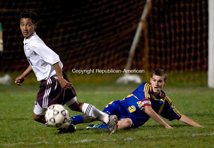 NAUGATUCK, CT -04 OCT 2006 -100406JT07--<br /> Naugatuck's Chris Fernandes and Seymour's Eric Lindemann look for the ball after Lindemann slide tackled while playing defense during Wednesday's game at Naugatuck. Naugatuck won 2-1.<br /> Josalee Thrift Republican-American