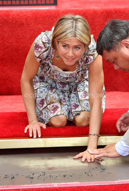 WWW.ACEPIXS.COM . . . . .  ..... . . . . US SALES ONLY . . . . .....July 7 2011, Los Angeles....Actress Jennifer Aniston at her hand and footprint ceremony on the Hollywood Walk of Fame at Grauman's Chinese Theater on July 7 2011 in Los Angeles....Please byline: FAMOUS-ACE PICTURES... . . . .  ....Ace Pictures, Inc:  ..Tel: (212) 243-8787..e-mail: info@acepixs.com..web: http://www.acepixs.com