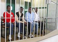 Da sinistra, Mohamed Isse Karshe, Abdi Hassan Mahamur, Ahmed Malimed Ali ed Abdullahi Ali Ahmed, presunti pirati somali accusati dell'attacco alla nave portacontainer italiana Montecristo, durante la prima udienza del processo presso la III Corte d'Assise a Roma, 23 marzo 2012. La nave, assaltata il 10 ottobre 2011 al largo della Somalia, venne liberata il 15 ottobre dai Royal Marines britannici con l'ausilio di una nave militare statunitense..Somali allegedly pirates, from left, Mohamed Isse Karshe, Abdi Hassan Mahamur, Ahmed Malimed Ali and Abdullahi Ali Ahmed, sit inside a cage during the opening audience for the assault to the Montecristo container ship, in Rome, 23 march 2012. The ship was attacked on 10 october 2011 and freed by US navy and British Royal Marines on 15 october..UPDATE IMAGES PRESS/Riccardo De Luca