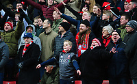 Lincoln City fans celebrate their teams goal, scored by Harry Toffolo<br /> <br /> Photographer Chris Vaughan/CameraSport<br /> <br /> The EFL Sky Bet League Two - Lincoln City v Grimsby Town - Saturday 19 January 2019 - Sincil Bank - Lincoln<br /> <br /> World Copyright &copy; 2019 CameraSport. All rights reserved. 43 Linden Ave. Countesthorpe. Leicester. England. LE8 5PG - Tel: +44 (0) 116 277 4147 - admin@camerasport.com - www.camerasport.com