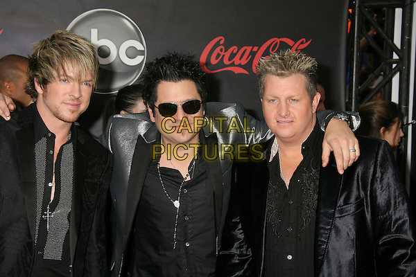 RASCAL FLATTS - Joe Don Rooney, Jay DeMarcus and Gary LeVox .2007 American Music Awards held at the Nokia Theatre LA Live, Los Angeles, California, USA, 18 November 2007..half length.CAP/ADM/RE.©Russ Elliot/AdMedia/Capital Pictures.