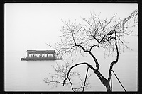 Visitors enjoy a boat tour at the West Lake in Hangzhou, Zhejiang province, China, March 2013.