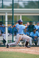 Tampa Bay Rays left fielder Pedro Diaz (92) follows through on a swing during an Instructional League game against the Pittsburgh Pirates on October 3, 2017 at Pirate City in Bradenton, Florida.  (Mike Janes/Four Seam Images)
