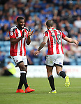 Sheffield United's Ethan Ebanks-Landell celebrates with goalscorer Kieron Freeman during the League One match at the Priestfield Stadium, Gillingham. Picture date: September 4th, 2016. Pic David Klein/Sportimage