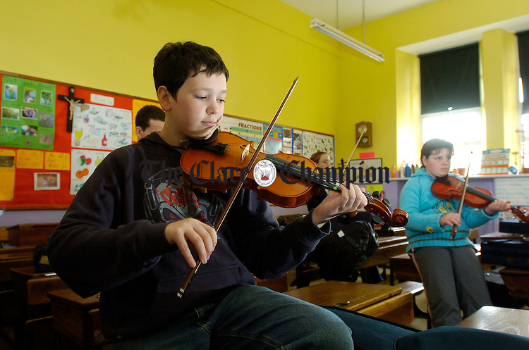 Dalian Rynne of Ennis and Joanne Maloney of Tulla in fiddle class during the Fleadh Nua in Ennis. Photograph by John Kelly.