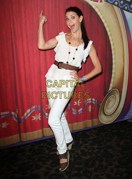 Samantha Harris.Los Angeles premiere of Ringling Bros. and Barnum & Bailey presents Fully Charged Held At The Staples Center Downtown Los Angeles, Los Angeles, California, USA..July 21st, 2011.full length white jeans denim top sleeveless brown belt shoes hand on hip mouth open pointing .CAP/ADM/KB.©Kevan Brooks/AdMedia/Capital Pictures.