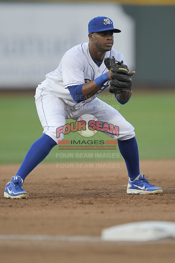 Omaha Storm Chasers third baseman Irving Falu #12 looks for the ball during the game against the Reno Aces at Werner Park on August 3, 2012 in Omaha, Nebraska.(Dennis Hubbard/Four Seam Images)