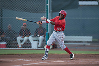 AZL Angels third baseman Daniel Ozoria (23) follows through on his swing during an Arizona League game against the AZL Giants Black at the San Francisco Giants Training Complex on July 1, 2018 in Scottsdale, Arizona. The AZL Giants Black defeated the AZL Angels by a score of 4-2. (Zachary Lucy/Four Seam Images)