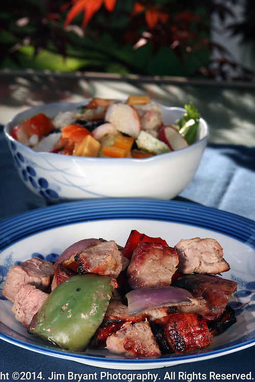 Barbecued shish kabobs beef tips with onions, yellow and red peppers served with salad with shrimp, crab meat, green, red and yellow peppers, cucumbers, mushrooms, tomatoes, Romaine lettuce, cauliflower, broccoli, snow peas and cheese. ©2014. Jim Bryant Photo. All Rights Reserved.