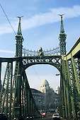 Budapest, Hungary. View from the Liberty Bridge, previously the Franz Josef Bridge, to the Gellert Hotel baths. The bridge is decorated with mythical Turul birds. Opened 1896.