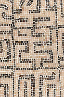 Kuba, a hand-chopped stone mosaic, is shown in tumbled Rosa Portagallo, Emperador Dark.