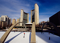 Toronto (ON) CANADA October 2001 - File Photo - .People ice skating on Nathan Phillips Square, in front of Toronto City Hall..The City Hall of Toronto, Ontario, Canada is one of the most distinctive landmarks of the city. Designed by Finnish architect Viljo Revell (with Heikki Castr??n, Bengt Lundsten, Seppo Valjus) and engineered by Hannskarl Bandel, the building opened in 1965; its modernist architecture still impresses today. It was built to replace Old City Hall which was built in 1899....photo by Pierre Roussel - Images Distribution