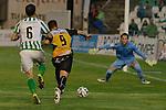 Sevilla, España, 15 de octubre de 2014: Luis Fernandez (C) avanza con el balon hacia la porteria de Dani (D) mientras FIgueras intenta detenerle (I) partido entre Real Betis y Lugo correspondiente a la jornada 5 de la Copa del Rey 2014-2015 celebrado en el estadio Benito Villamarain de Sevilla.