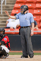 "Home plate umpire Tim Rosso gives the pitcher the ""wait"" sign during a South Atlantic League game between the Rome Braves and the Hickory Crawdads at  L.P. Frans Stadium May 23, 2010, in Hickory, North Carolina.  The Rome Braves defeated the Hickory Crawdads 5-1.  Photo by Brian Westerholt / Four Seam Images"