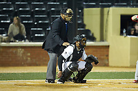 Wake Forest Demon Deacons catcher Christian Long (19) sets up as home plate umpire Gregory Street looks on during the game against the Sacred Heart Pioneers at David F. Couch Ballpark on February 15, 2019 in  Winston-Salem, North Carolina.  The Demon Deacons defeated the Pioneers 14-1. (Brian Westerholt/Four Seam Images)
