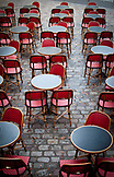 FRANCE, Paris, red parisian bistro's chairs and tables outdoors