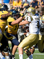 Mike Mohamed of California tries to sack UCLA quarterback Kevin Prince during the game at Memorial Stadium in Berkeley, California on October 9th, 2010.   California defeated UCLA, 35-7.
