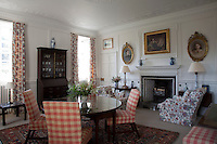 Comfortable armchairs and a carpeted floor contribute to the cosy feel of this living room