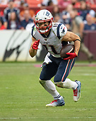 New England Patriots wide receiver Julian Edelman (11) carries the ball after making a reception in the fourth quarter against the Washington Redskins at FedEx Field in Landover, Maryland on Sunday, October 6, 2019.  The Patriots won the game 33 - 7.<br /> Credit: Ron Sachs / CNP