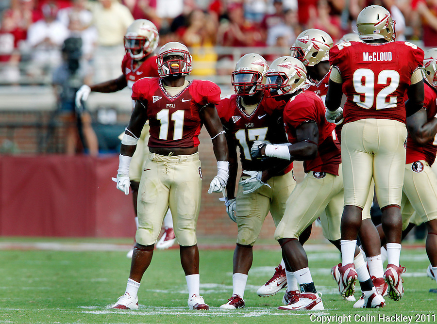 TALLAHASSEE, FL 9/3/11-FSU-ULM FB090311 CH-Florida State's Vince Williams, left, celebrates a sack with defensive team mates during second half action of the University of Louisiana at Monroe's Saturday at Doak Campbell Stadium in Tallahassee. The Seminole's beat the Warhawks 34-0. .COLIN HACKLEY PHOTO