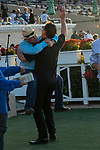 DEL MAR, CA  SEPTEMBER 2: Trainer Peter Miller jumps into the arms of owner Gary Hartunian after #7 Nucky, ridden by Norberto Arroyo, Jr., wins the Runhappy Del Mar Futurity (Grade l) on September 2, 2019, at Del Mar Thoroughbred Club in Del Mar, CA.( Photo by Casey Phillips/Eclipse Sportswire/CSM)