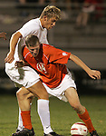 1 November 2006: Clemson's Jeff Routh (14) plays position defense against Virginia's Yannick Reyering (left). Virginia defeated Clemson 2-0 at the Maryland Soccerplex in Germantown, Maryland in an Atlantic Coast Conference college soccer tournament quarterfinal game.