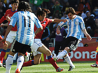 A South Korean defender steps up to block a shot by Argentina's Lionel Messi. Argentina defeated South Korea, 4-1, in both teams' second match of play in Group B of the 2010 FIFA World Cup. The match was played at Soccer City in Johannesburg, South Africa June 17th.