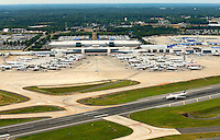 Aerial photography of Charlotte Douglas International Airport, in Charlotte, NC. Charlotte was the 6th busiest airport in the world, based on traffic movements, and in 2013 it was the 23rd busiest airport in the world by passenger traffic.<br /> <br /> Charlotte Photographer - PatrickSchneiderPhoto.com