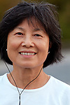Asian woman listening to ipod smiling