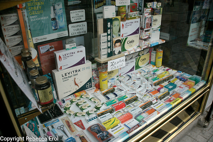 Display of medicines in the window of a chemist's shop, Turkey