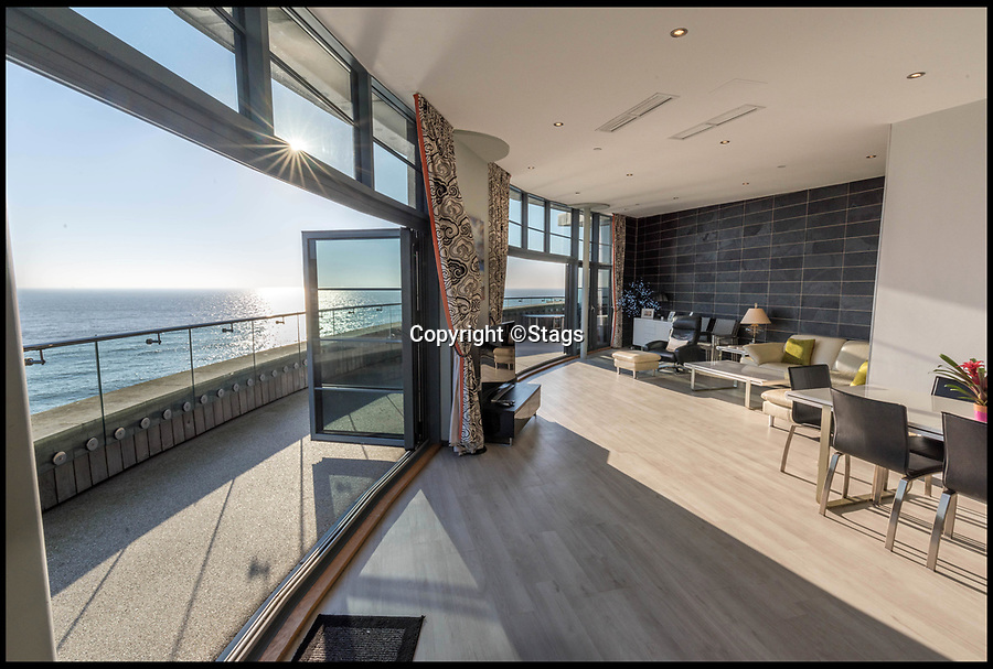 BNPS.co.uk (01202 558833)Pic:  Stags/BNPS<br /> <br /> Broadchurch star Pauline Quirke is selling her seaside flat in the exclusive complex that doubled as the police station in the hit TV crime drama.<br /> <br /> The London actress bought the penthouse apartment in West Bay, Dorset, during the filming of the second season of Broadchurch in 2014.<br /> <br /> Quirke, 59, played the shifty character of Susan Wright in the ITV whodunnit series that was based in the seaside town.<br /> <br /> She has used the flat as a holiday home since then but has now put its on the market.