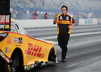 Mar. 9, 2012; Gainesville, FL, USA; NHRA crew member for funny car driver Jeff Arend during qualifying for the Gatornationals at Auto Plus Raceway at Gainesville. Mandatory Credit: Mark J. Rebilas-