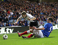 Lee Wallace tackles Danny Carmichael in the Rangers v Queen of the South Quarter Final match in the Ramsdens Cup played at Ibrox Stadium, Glasgow on 18.9.12.